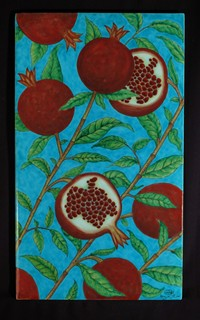 One-piece tile with pomegranate pattern